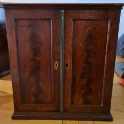 A wonderful mahogany coin cabinet, ex Baldwin, size approx 36 x 33 x 28cm