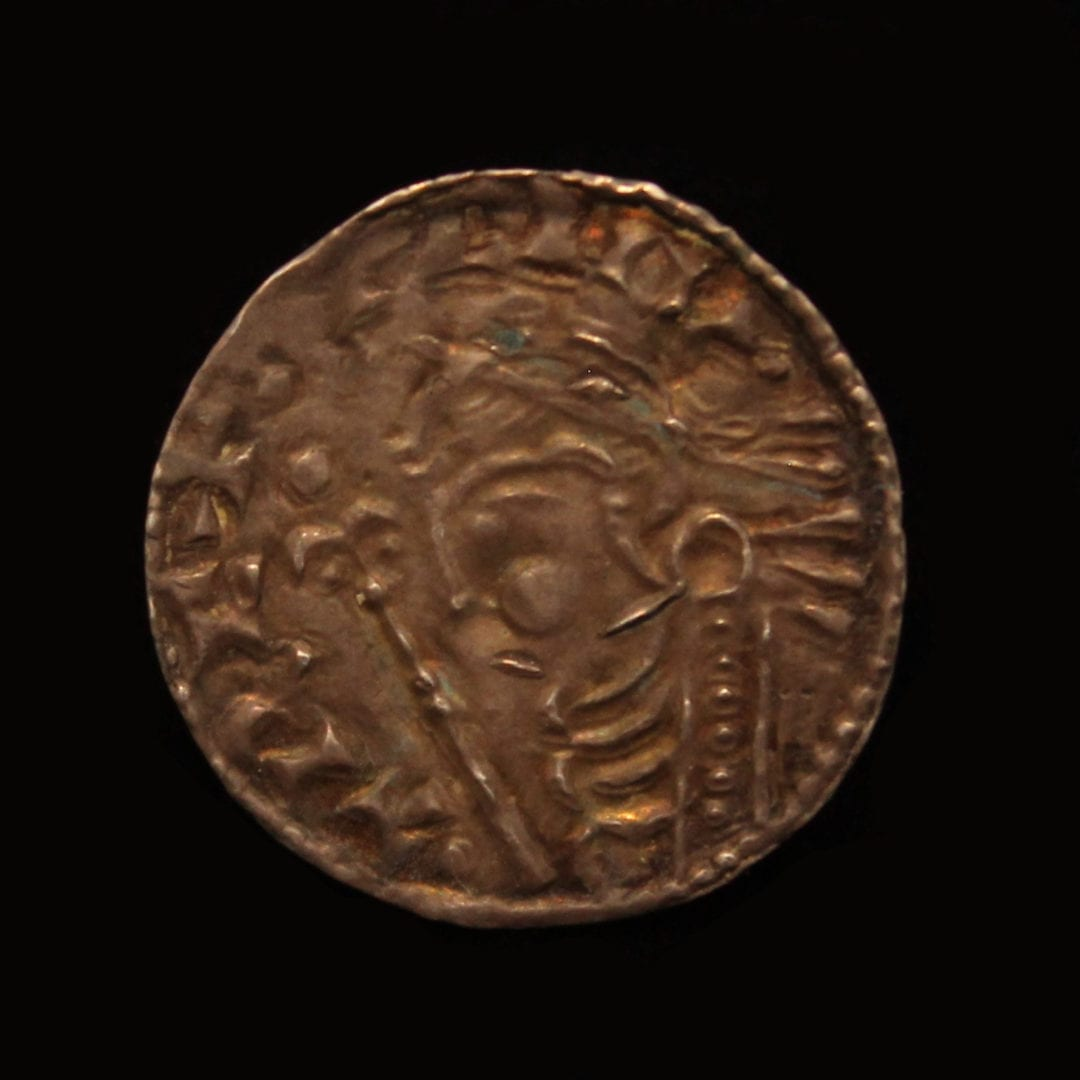 Cnut Penny Short Cross Type, Obverse, CNUT REC, bust left, diademed; sceptre with lis head, Reverse, Short Cross voided, a circle enclosing a pellet, COLBRIN on LINC,