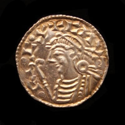 Cnut Penny Short Cross Type, Obverse, CNUT REC, bust left, diademed; sceptre with lis head, Reverse, Short Cross voided, a circle enclosing a pellet, OSLAC on LINCOL Weight 1.1grms, bright hoard coin