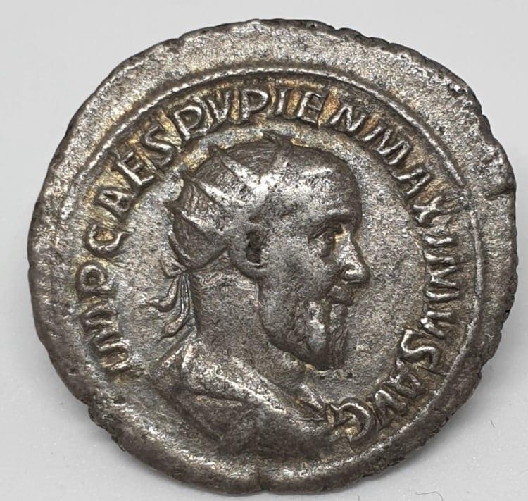 Pupienus (238 A.D), Silver Antoninianus. Minted in Rome, 238 A.D. PATRES SENATVS, clasped hands IMP CAES PVPIEN MAXIMVS AVG, radiate, draped and cuirassed bust of Pupienus right